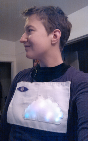 The author wearing a T-shirt with a glowing cloud design