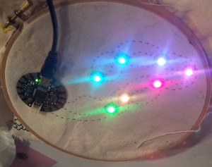 Seven LEDs are lit in a rainbow pattern at full brightness